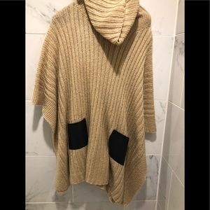 Camel poncho with black faux leather pockets